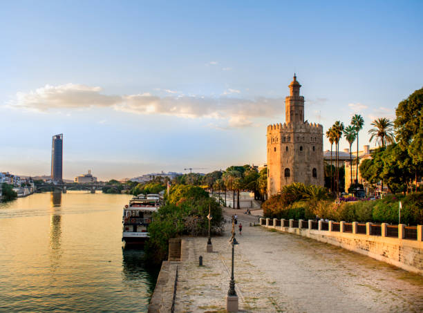 Torre del Oro Golden hour hitting the Torre del Oro in Seville seville stock pictures, royalty-free photos & images