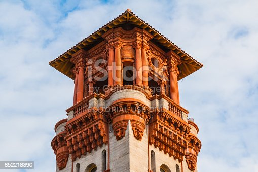 Saint Augustine, Florida, USA - January 18, 2016: Bottom view of the tower of Lightner Museum on the background of cloudy sky in sunny day