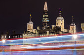 LONDON, UK - FEBRUARY 16TH 2017: A panoramic night-time view of the Tower of London with the Shard skyscraper in the distance and light trails, on 16th February 2017.