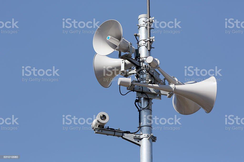 Tower of loudspeaker against blue sky stock photo