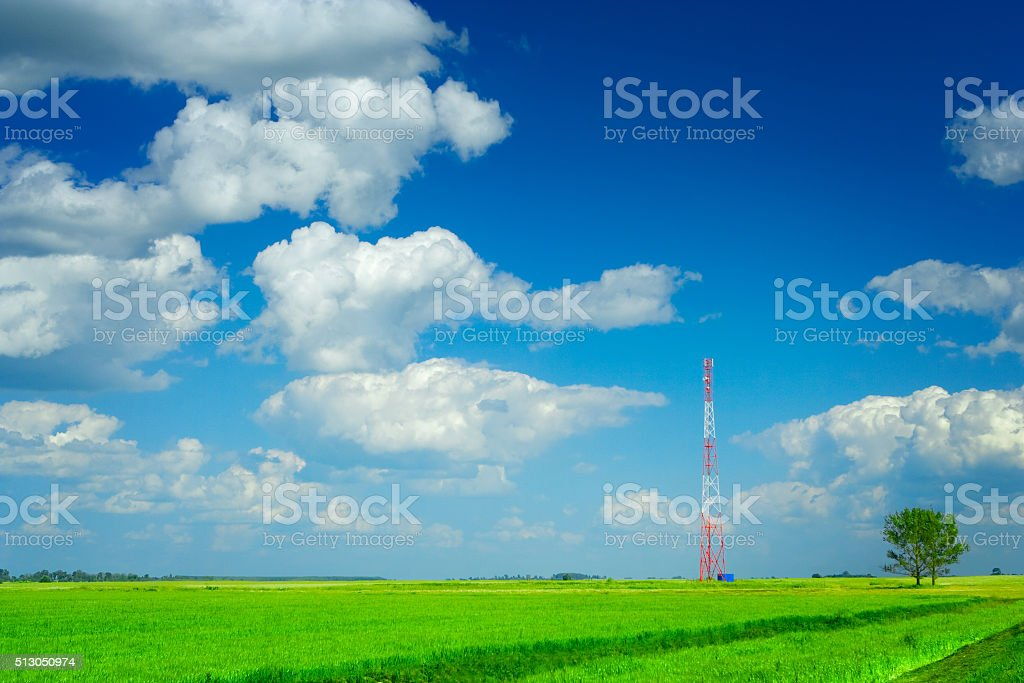 Tower of mobile communication on a field stock photo