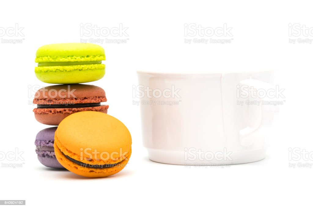 Tower of sweet macarons and a cup of hot tea stock photo