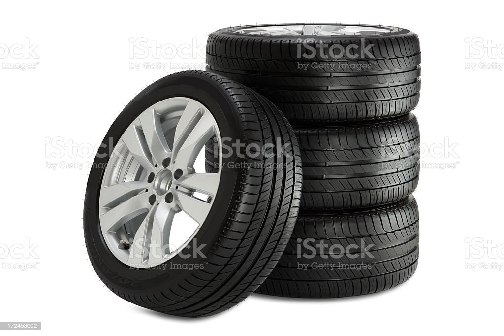 Tower of three car wheels and 1 wheel on the side stock photo