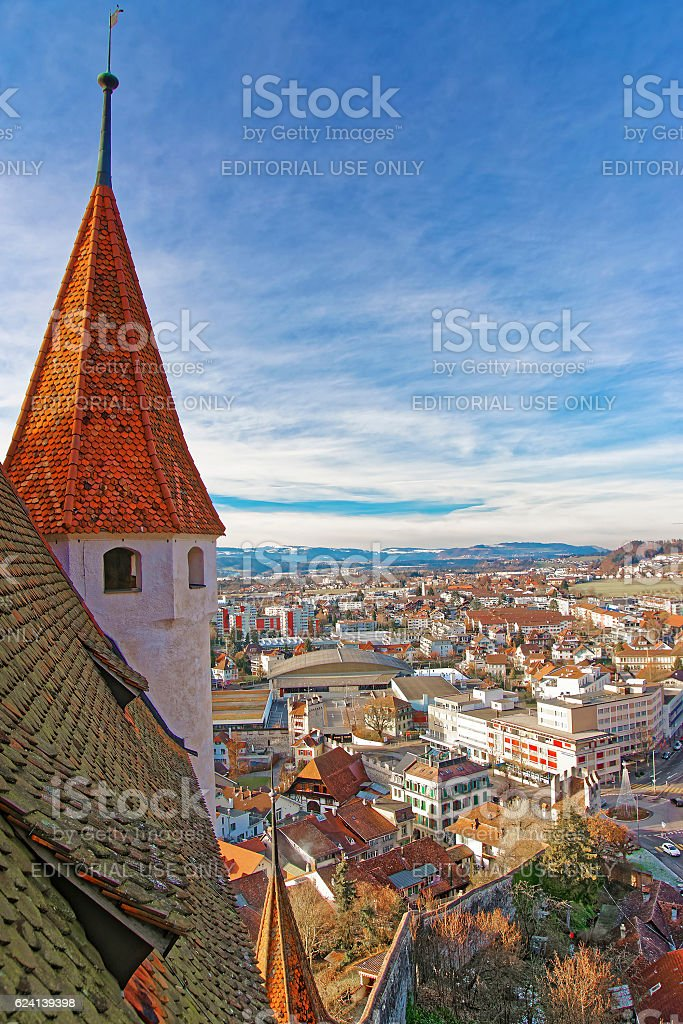 Tower of Thun Castle with Panorama of Town and Alps stock photo