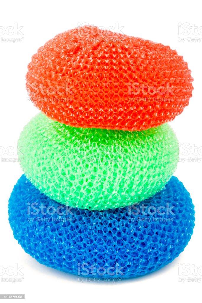 Tower of vibrant plastic scourers stock photo