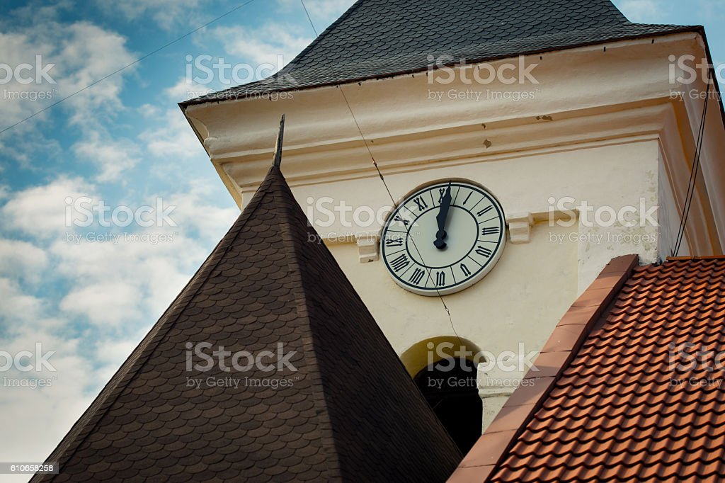 Tower old clock on background of blue sky with clouds stock photo