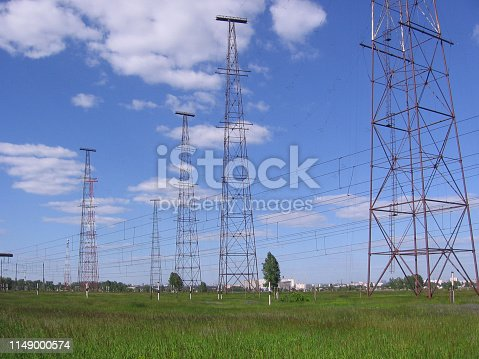 TV tower on blue sky background with satellite antennas and radio signals