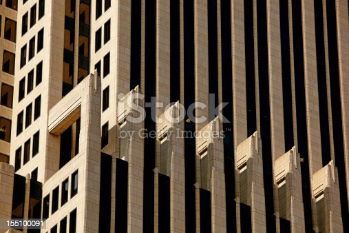 Close up with 200mm f2.8 of NBC Tower's facade. Designed by Adrian D. Smith the NBC Tower is considered one of the finest reproductions of Art Deco style. The tower uses limestone piers and recessed tinted glass with granite spandrels.
