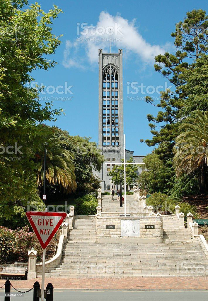 Tower structure in the middle of two trees with tall steps stock photo