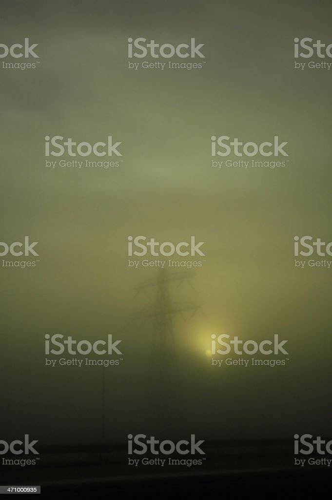 Tower with high-voltage cables in the fog royalty-free stock photo