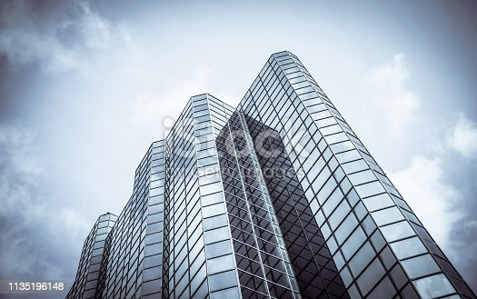 Abstract Diagonal Perspective Of A Towering Downtown Glass And Steel Skyscraper With Copy Space