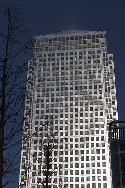 canary wharf skyscraper in london's docklands - whiteway money stock photos and pictures