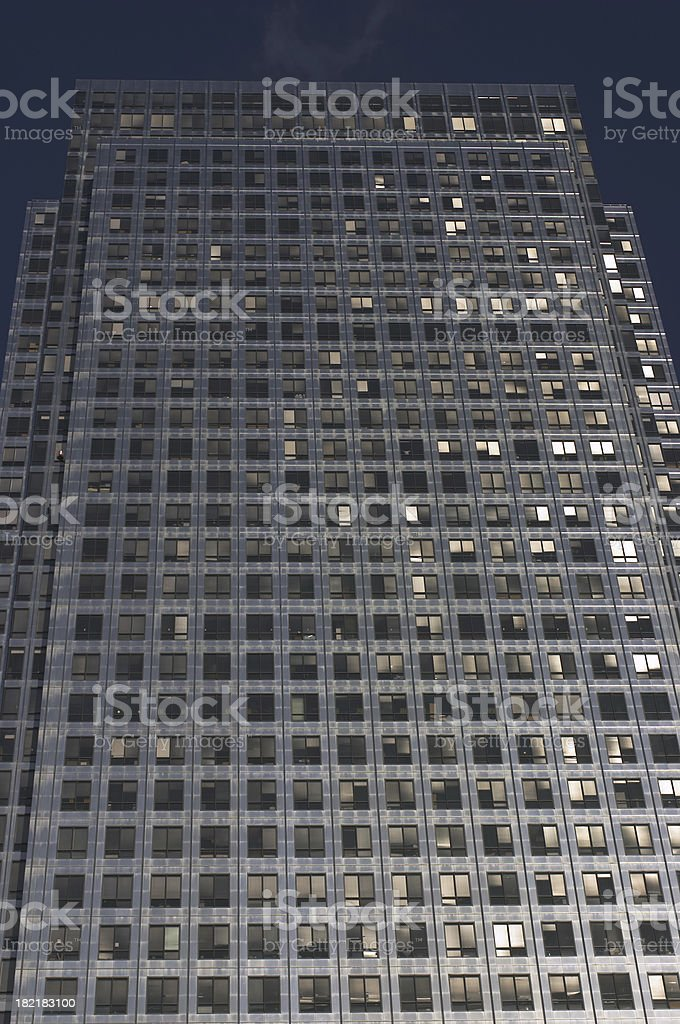 High rise at Canary Wharf skyscraper and dark sky royalty-free stock photo
