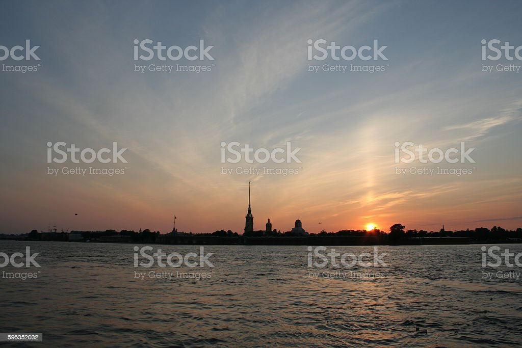 Towers and pillars of fortress and sunset on Neva river royalty-free stock photo