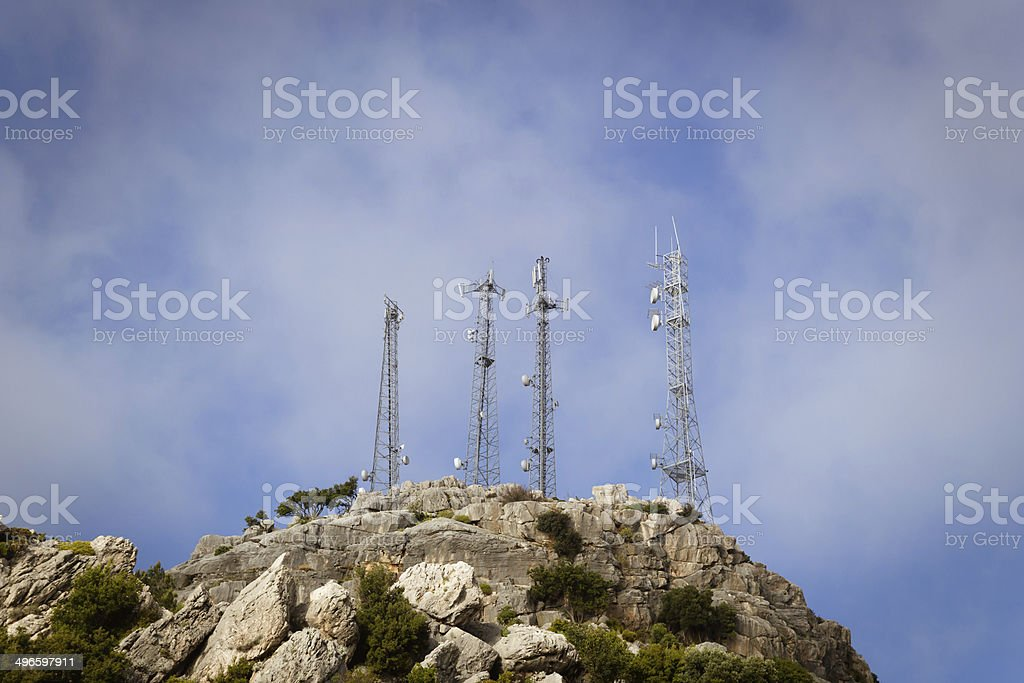 GSM Towers at rocky peak stock photo