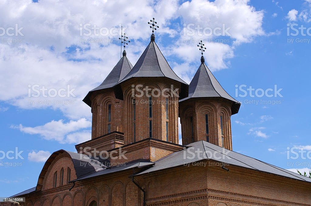 Towers of old church in Targoviste, Romania stock photo