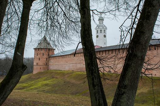 Towers of the Novgorod Kremlin behind the trees, Russia