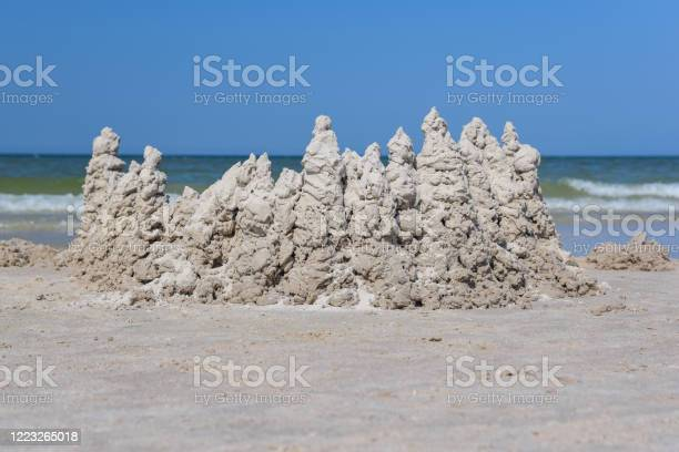 Photo of Towers with sand on a beach
