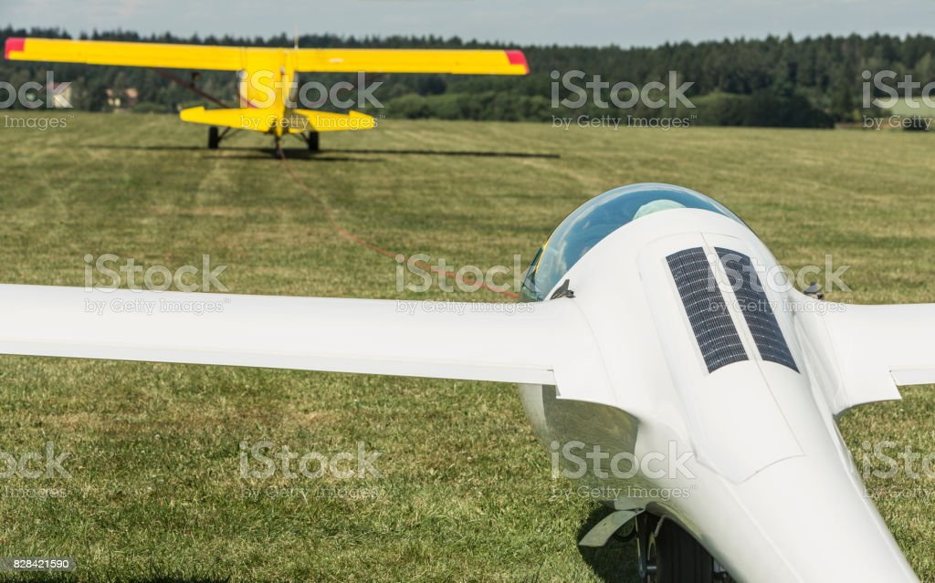 towing gliders when starting on a grass runway in sunny day stock photo