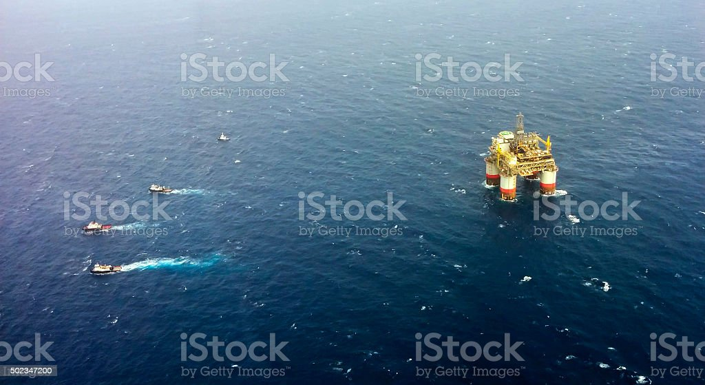 Towing Oil Rig Offshore Louisiana stock photo