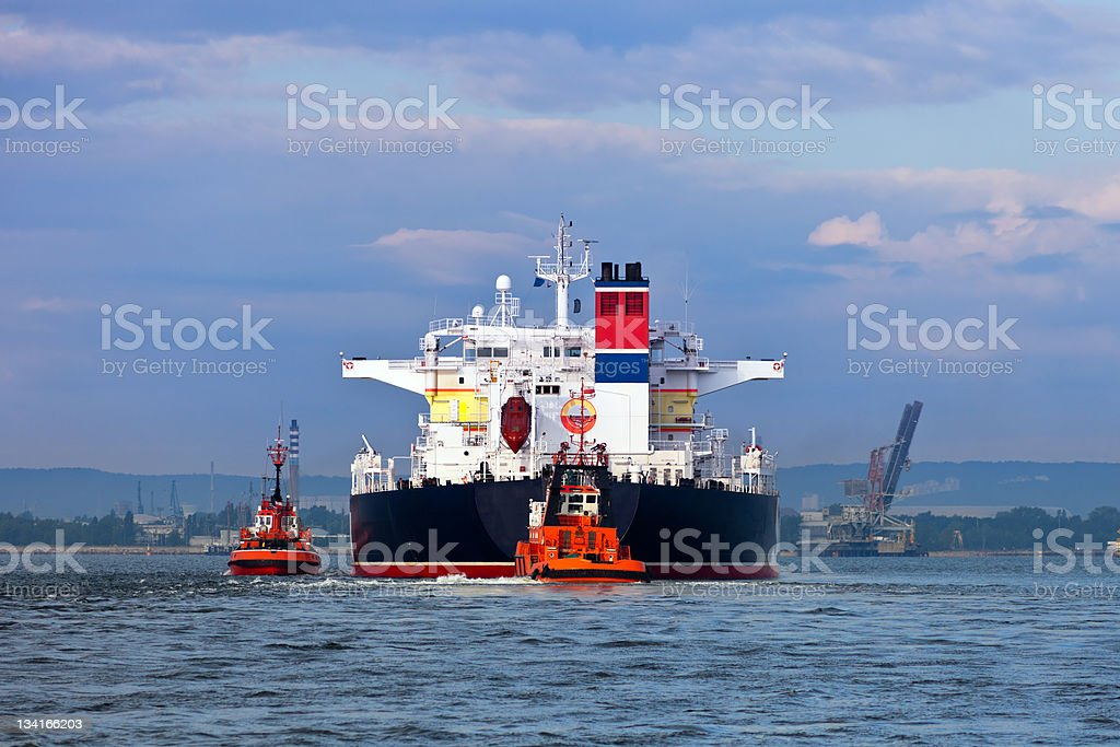 Towing the tanker royalty-free stock photo