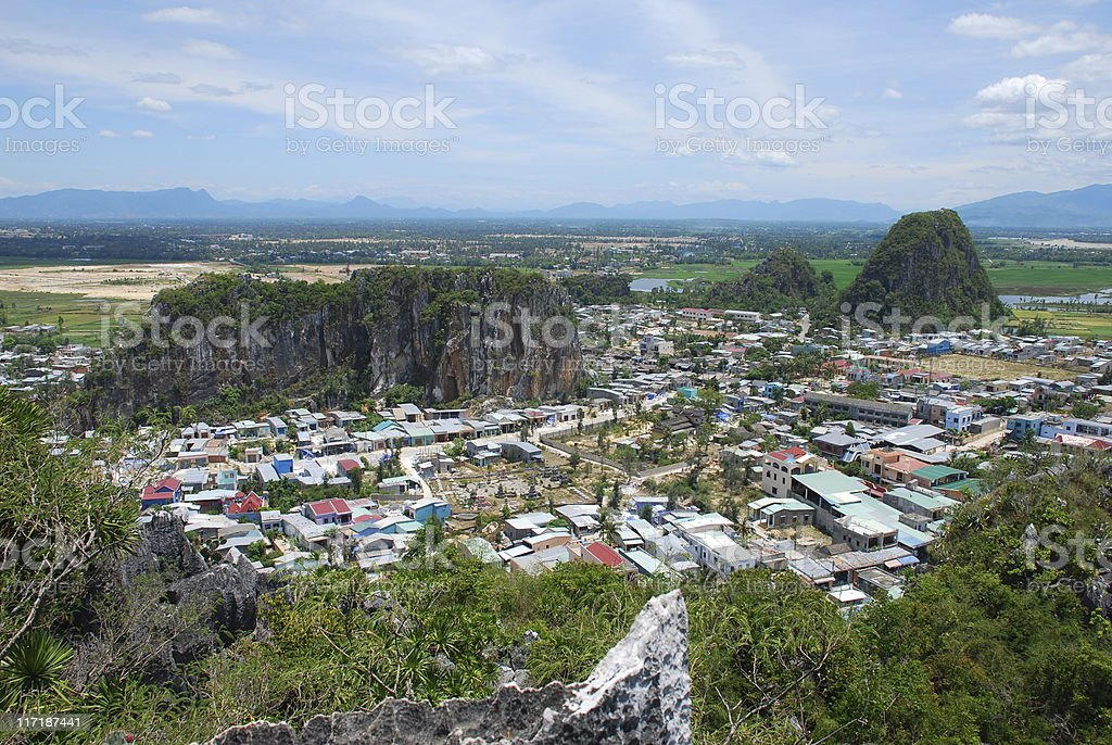 Town and Karst Formations at Marble Moiuntains in Vietnam royalty-free stock photo