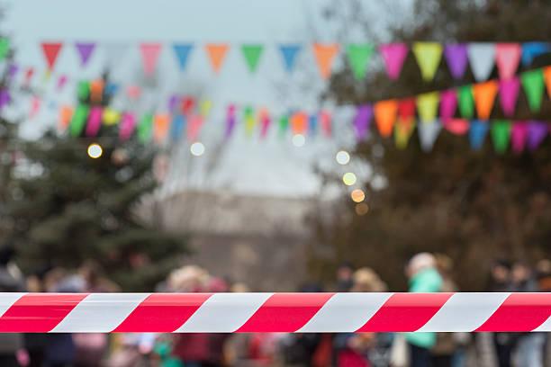 town celebration defocused crowd behind red cordon tape - horizontal gestreiften vorhängen stock-fotos und bilder