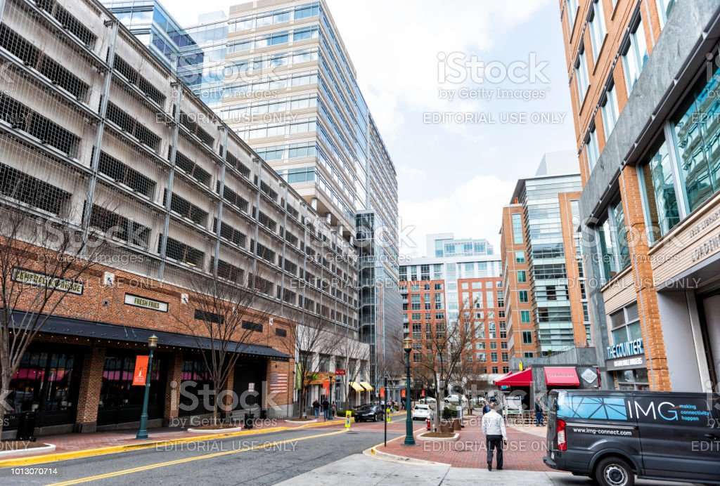 Town center building architecture, sidewalk street road during day, Democracy Drive in northern Virginia stock photo