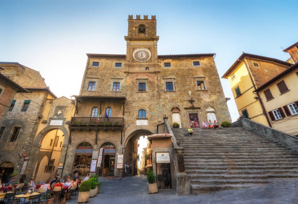 town hall in Cortona, Tuscan , Italy Cortona, Italy - August 9, 2017: tourists in front of The town hall in Cortona, Tuscan , Italy arezzo stock pictures, royalty-free photos & images