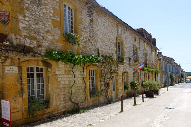 Town hall in the medieval bastide town of Monpazier Monpazier, France July 2020: Town hall in the medieval bastide town of Monpazier is the Dordogne region of France ville stock pictures, royalty-free photos & images