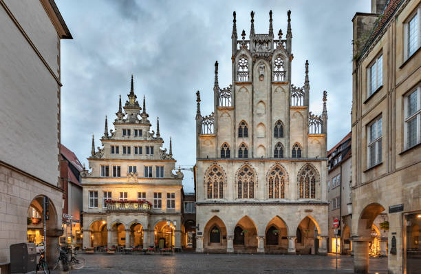 Town Hall of Münster in Germany Gable of the city wine house and townhall at Prinzipalmarkt, Muenster, Muensterland, North Rhine-Westphalia, Germany north rhine westphalia stock pictures, royalty-free photos & images