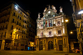 Night view of the City Hall of Pamplona. From the balcony of this building every year starts the Sanfermines, the biggest festival in the city and one of the most famous celebrations in the world.