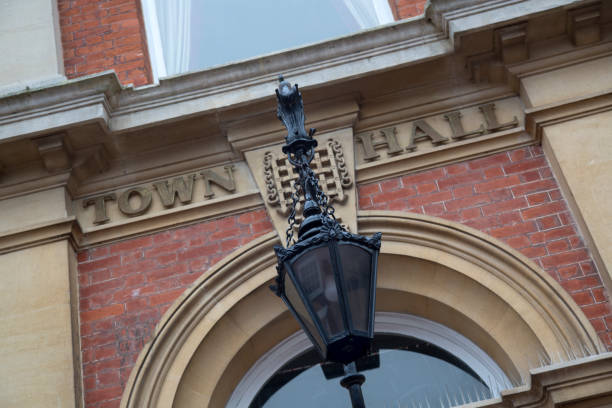Town Hall Sign on Building Town Hall Sign on Building Facade town hall stock pictures, royalty-free photos & images