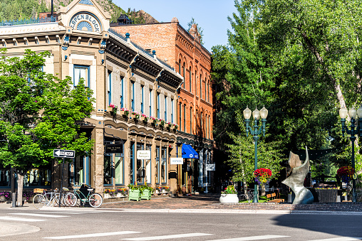 Aspen, USA - June 27, 2019: Town in Colorado with vintage architecture on street park square in luxury expensive famous city during summer day