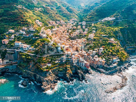Aerial view of town in mountains towering over tranquil sea, CinqueTerre, Italy