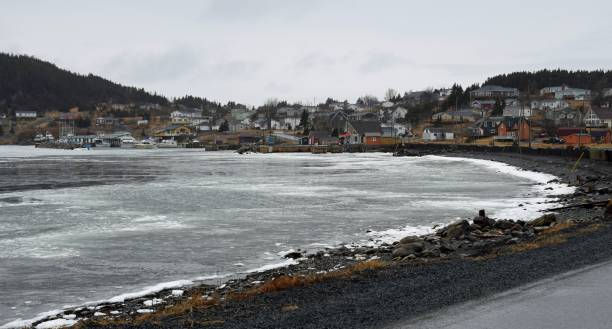 town of Dildo, Newfoundland view across the ice covered bay towards the town of Dildo, early spring scene at the Trinity Bay along the Baccalieu trail, Newfoundland Canada dildo stock pictures, royalty-free photos & images