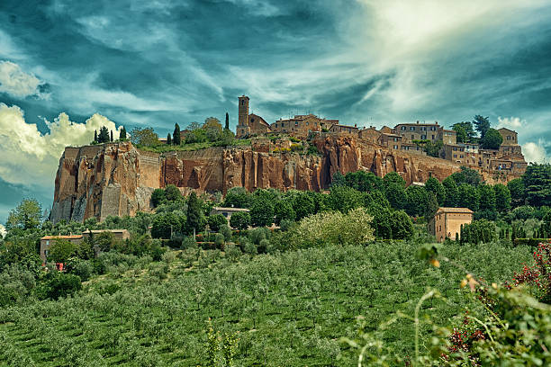 Town of Orvieto, Umbria, Italy, toned View at ancient town of Orvieto, Umbria, Italy, toned image tuff stock pictures, royalty-free photos & images