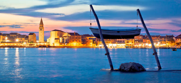 Town of Umag waterfront and coast evening view Town of Umag waterfront and coast evening view, tourist destination in Istria, Croatia croatian culture stock pictures, royalty-free photos & images