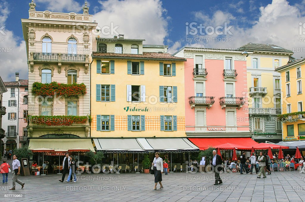 Town Square Lined with Restaurants and Colorful Houses, Lugano, Switzerland. stock photo