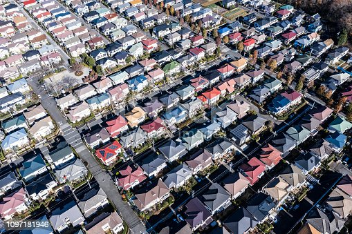 Aerial photograph of residential area characterized by colorful roof