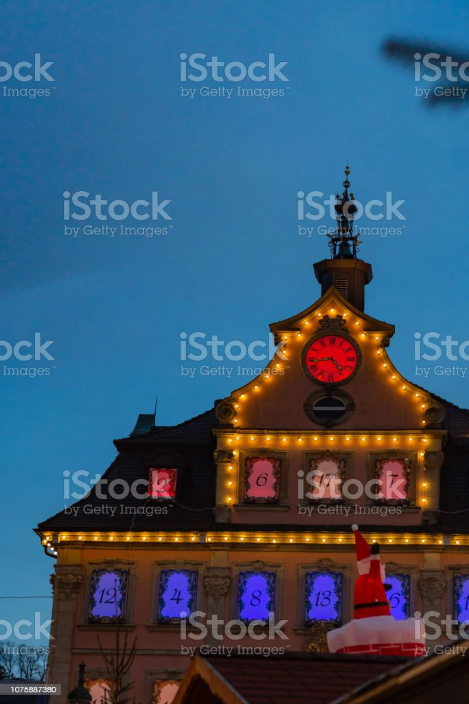 townhall christmas lights at market place in advent december blue...