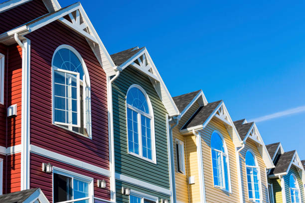 Townhouse Row A row of colorful new townhouses or condominiums. townhouse stock pictures, royalty-free photos & images