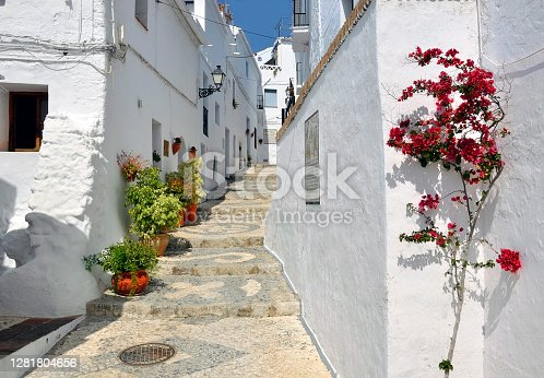 istock Townhouses along a typical whitewashed village street 1281804656