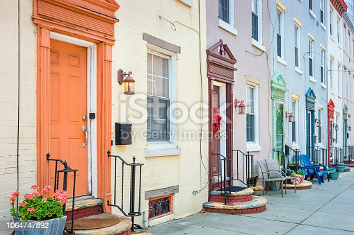 Stock photograph of a row of townhomes with colorful front doors in downtown Philadelphia Pennsylvania USA.