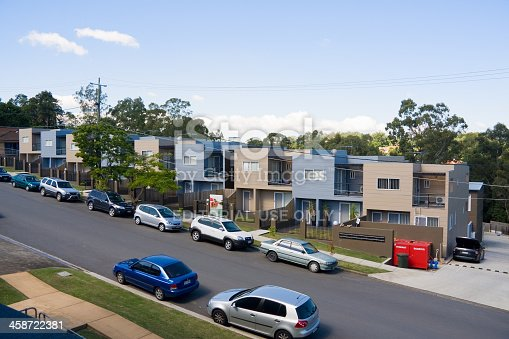 istock Townhouses on a busy street 458722381