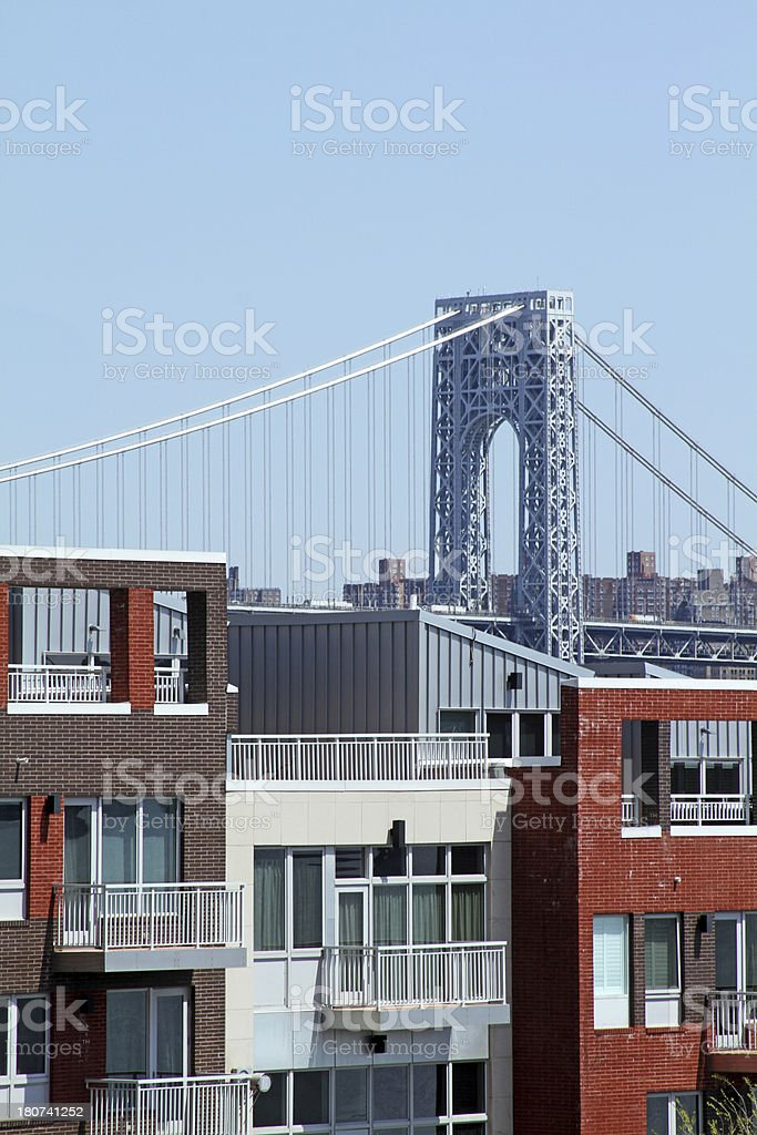 Townhouses with bridge in background royalty-free stock photo