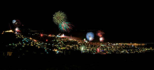 towns of ermoupolis and ano syros on the greek island of syros, cyclades, with fireworks in the night of resurrection, in greek easter - greek easter stock photos and pictures