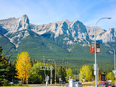 Townscape and Mountain range of Canmore in autumn, Kananaskis Country, Canadian Rockies, Alberta, Canada
