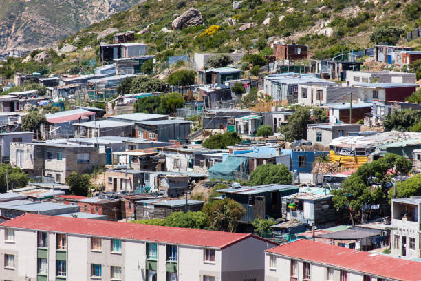 Township in Hout Bay near Cape Town in South Africa Township in Hout Bay near Cape Town in South Africa. Some shacks are burnt down. Image taken with Canon 5Ds. hout stock pictures, royalty-free photos & images