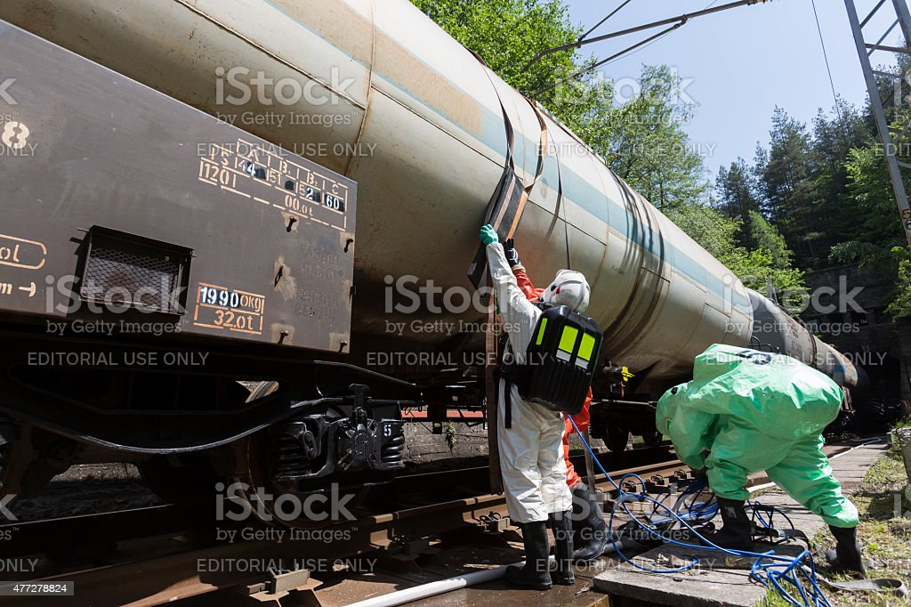 Toxic chemicals acids emergency team near tank stock photo